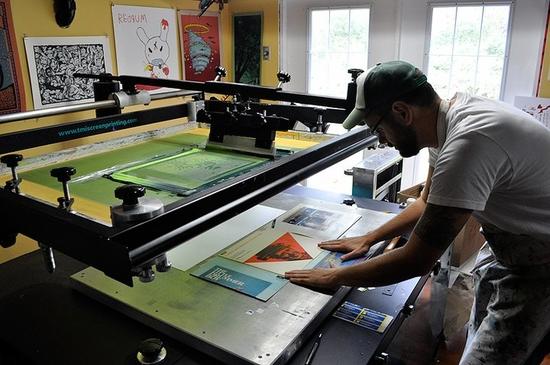 McCue prepares some record artwork.