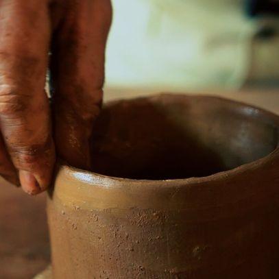 Finishing the rim on a coiled mug