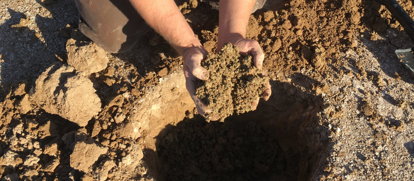 natural clay being dug from the ground