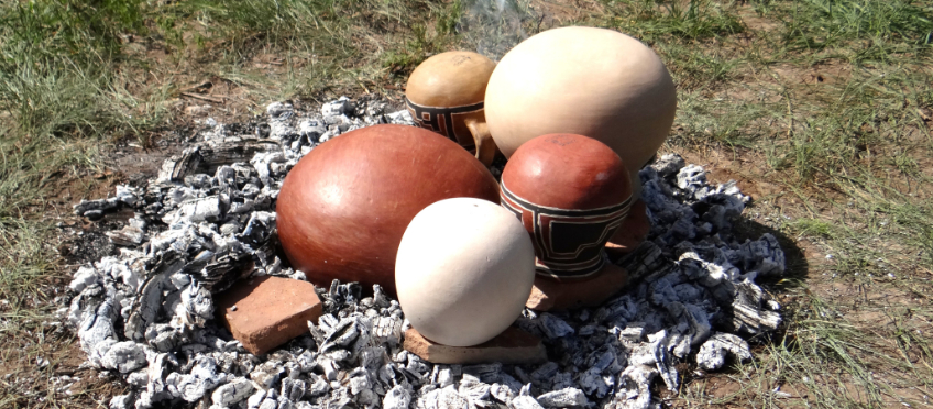 Red and brown wares ready for a traditional firing