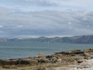 The beach at Penmon, with view of Snowdonia