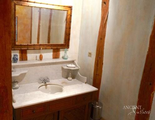 farmhouse-bathroom-antique-limestone-sink