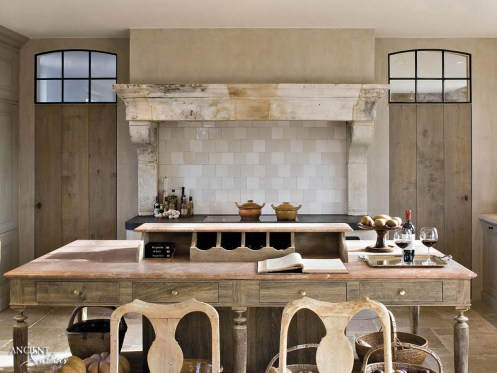 french-farmhouse-with-limestone-countertop-and-kitchen-hood