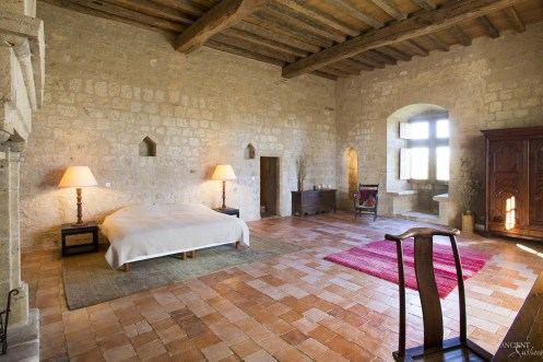 farmhouse-master-bedroom-with-limestone-flooring-wall-cladding-antique-limestone-fir