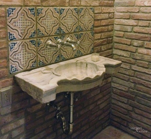 Antique Reclaimed Marble Sink in a Mid-Century Style Bathroom
