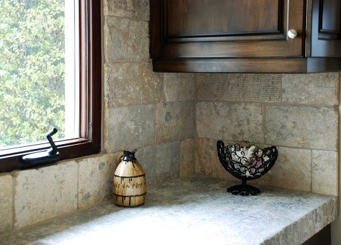 Antique Biblical Stone on Backsplash and Foundation Slabs Butcher Blocks on Counters