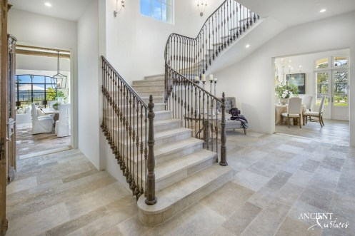farmhouse-living-area-with-limestone-flooring-and-stone-stairs