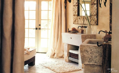 his=and-her-bathroom-sink-made-out-of-limestone-stone