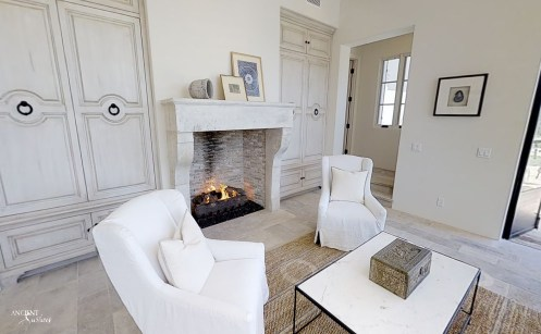living-room-with-limestone-flooring-and-limestone-antique-fireplace-stone