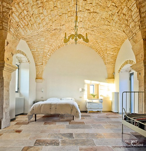 master-bedroom-antique-limestone-flooring-wall-cladding