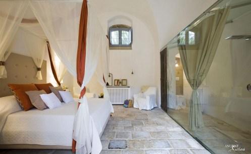 antique-farmhouse-provence-master-bedroom-limestone-flooring