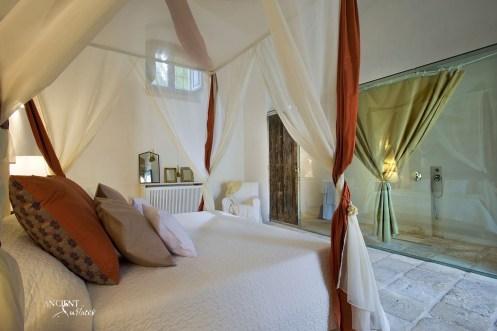 master-bedroom-with-stone-floors-flooring