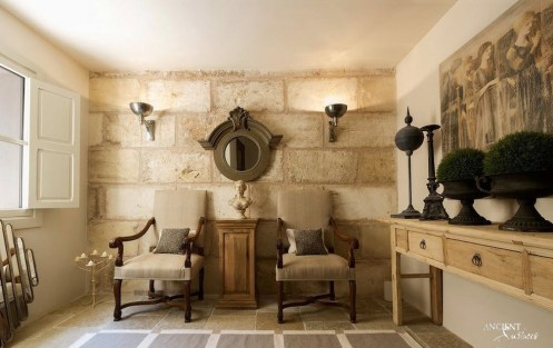 beautiful-antique-looking-living-room-with-limestone-wall-cladding-an stone-floors