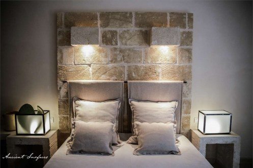 french-farmhouse-ancient-surfaces-bedroom-with-limestone-wall-cladding