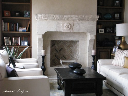 living-room-area-with-limestone-fireplace-stone-stove
