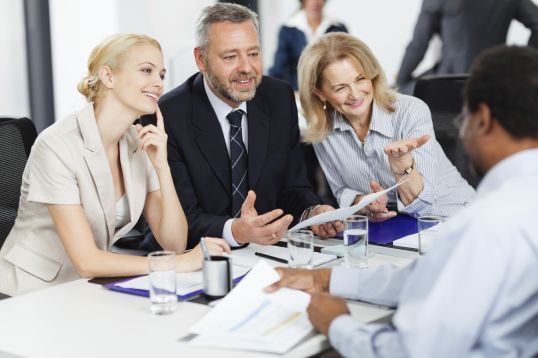 smiling-businesspeople-discussing-on-a-meeting-161922112-56ffed213df78c7d9e5c164b