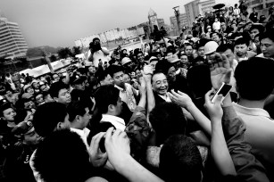 "The premier of China, Wen Jiabao has become the face of the Chinese government during the catastrophe. ""Grandpa"" as he is called is here seen visiting a group of factory workers that survived the quake."