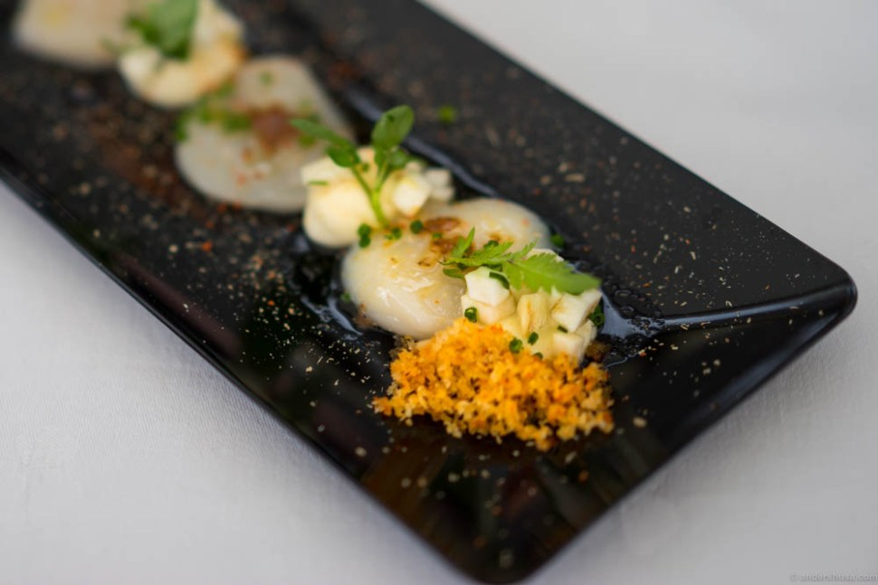 Marinated raw scallops , celeriac cream, pickled celeriac, miso brown butter, cress and potato crumbs. Full of flavor and contrasts without killing the gentle taste of the scallops
