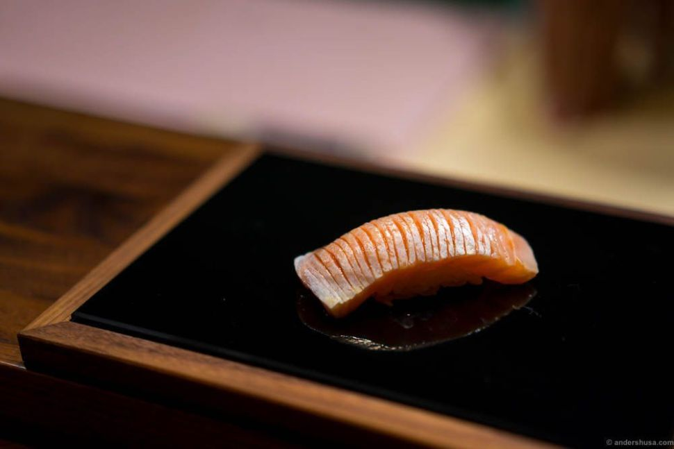"""Salmon """"toro"""" with soy sauce. The fatty belly part of the fish."""