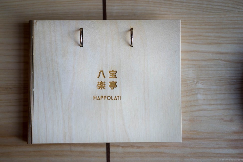The menu at Happolati is made of wood.