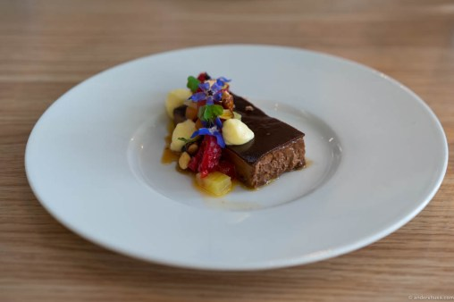 Chocolate sandwich with raspberries from Brimse, flowers, passion fruit cream, papaya and pineapple