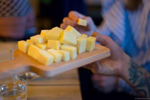 Gitte and Filip munching cheese
