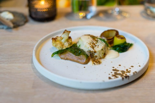 Monkfish, burnt cauliflower, caramelized cauliflower purée, burnt leek and wakame with a sauce on mussels