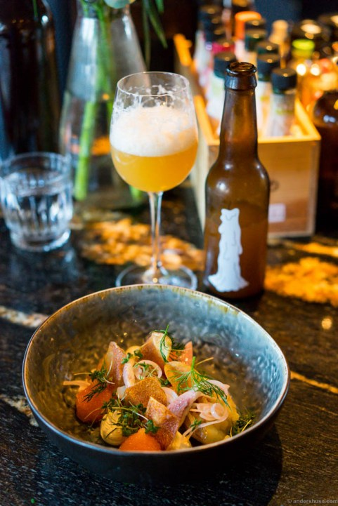 """From North to South"" – Crushed new potatoes with sour cream, Kalix caviar, spring onion & smoked silver eel. Omnipollo Mazarin, pale ale brewed with oats, in the glass."
