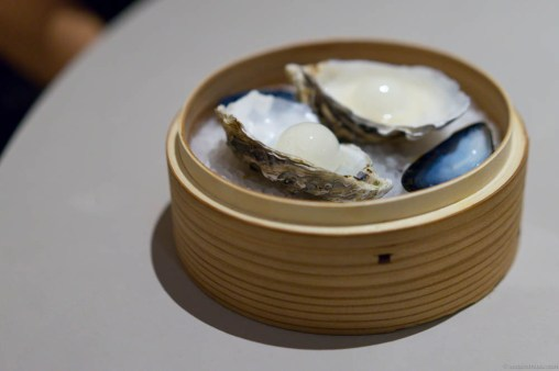 Oyster en surprise. A palate cleanser of a gin & tonic sphere.