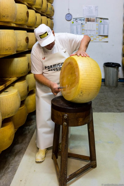 After 12 months of aging, each cheese wheel is knocked with a hammer to determine the quality