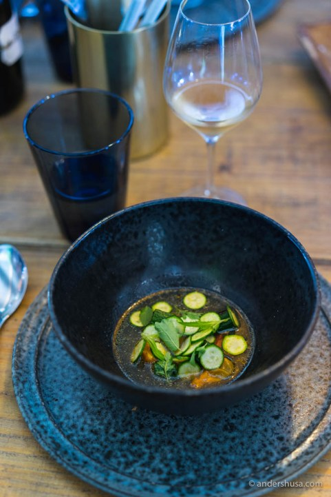 A broth with dried tomatoes, squash and herbs