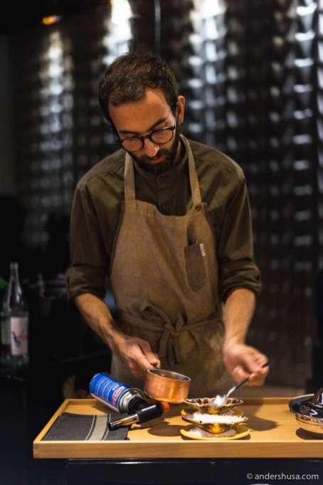 Chef Henrique Castilho prepares the next dish tableside