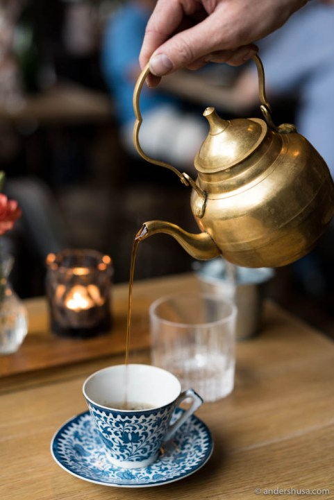 Coffee served from an old-school brass-colored pot