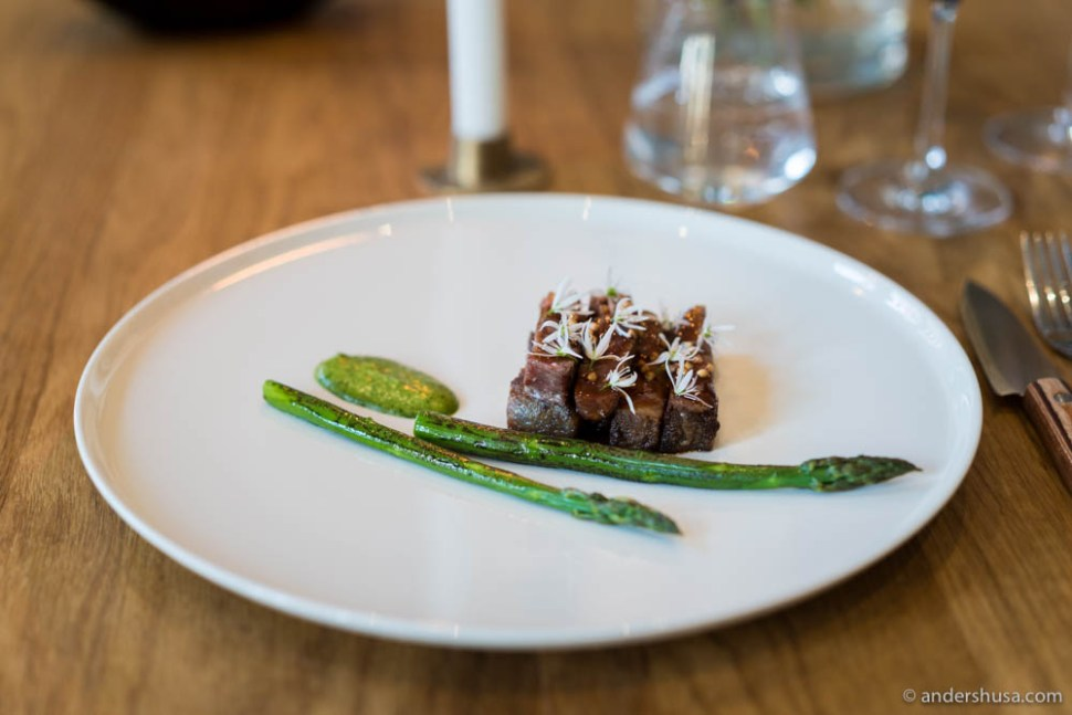 Milk cow, asparagus from Hvasser, ramson flowers, a paste of cress, potatoes and browned butter, and a beef glace with parsley vinegar & toasted buckwheat