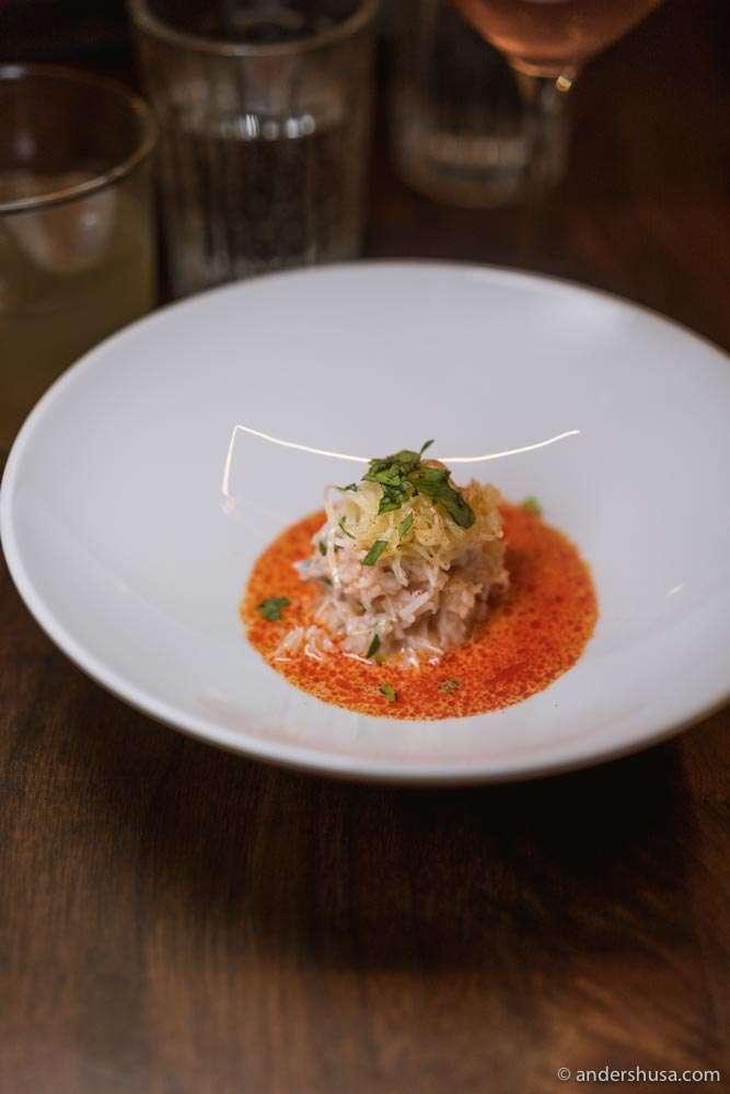 Brown crab and a sauce of almonds, nduja fat, celeriac, & tarragon.