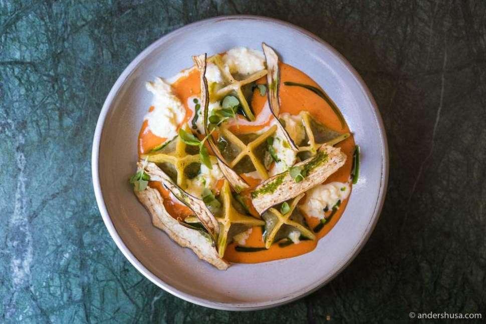 Aubergine ravioli with stracciatella and a cold tomato coulis.
