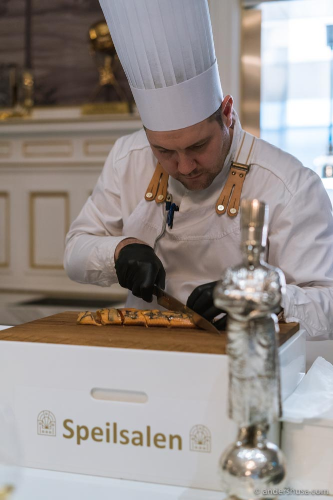 Christopher Davidsen hard at work with Paul Bocuse watching from the sideline.