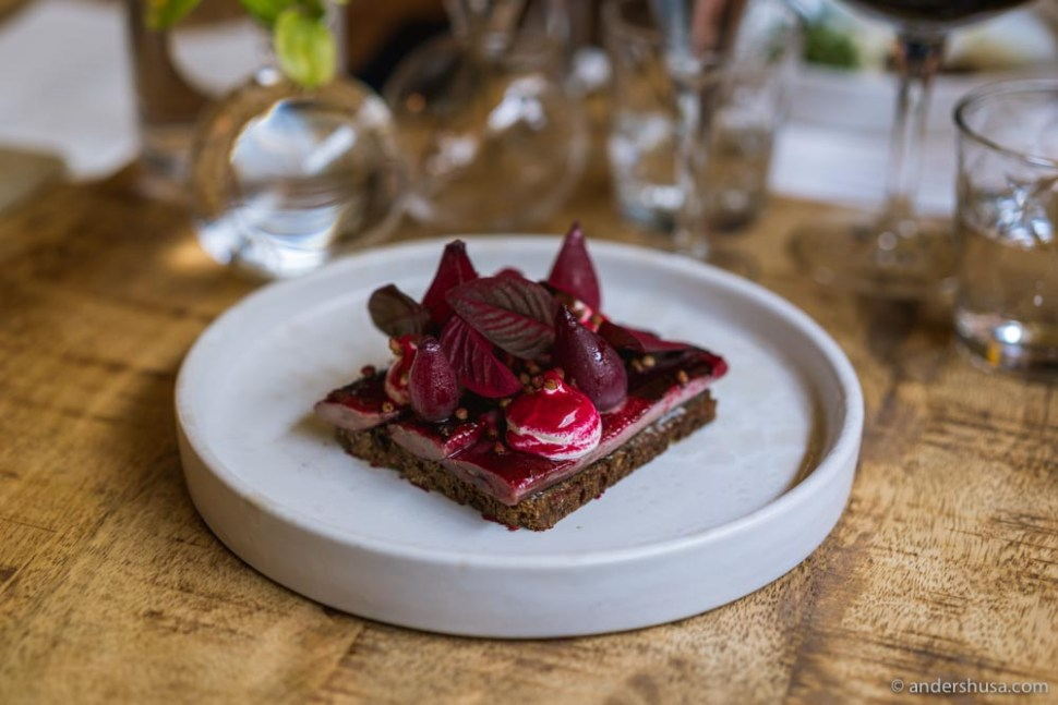 Blackcurrant herring with red onion, crème fraîche, and buckwheat.
