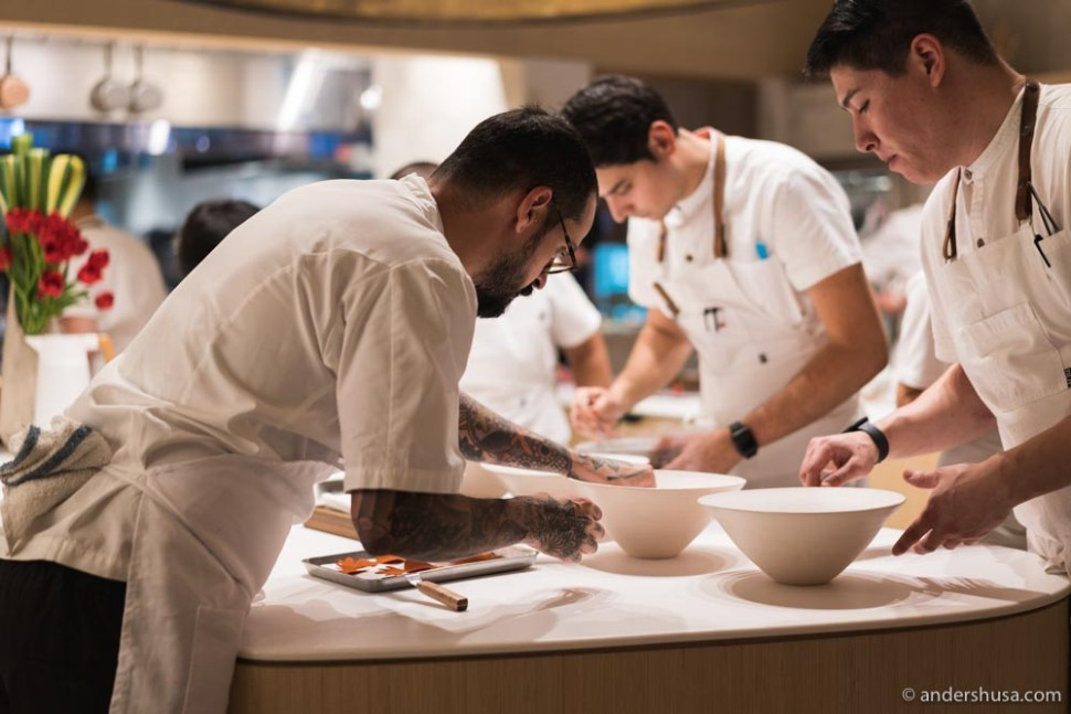 Chef Aitor Zabala plating in the open kitchen.