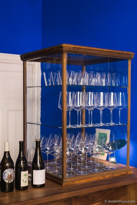 A glass cabinet with Zalto glasses sits atop the bar.