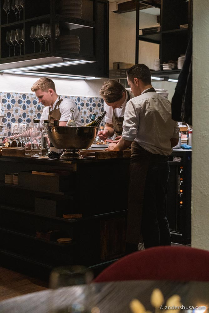 Chefs hard at work in the cozy kitchen.