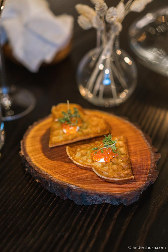 Potato waffles with whipped cream, trout roe, and dill.