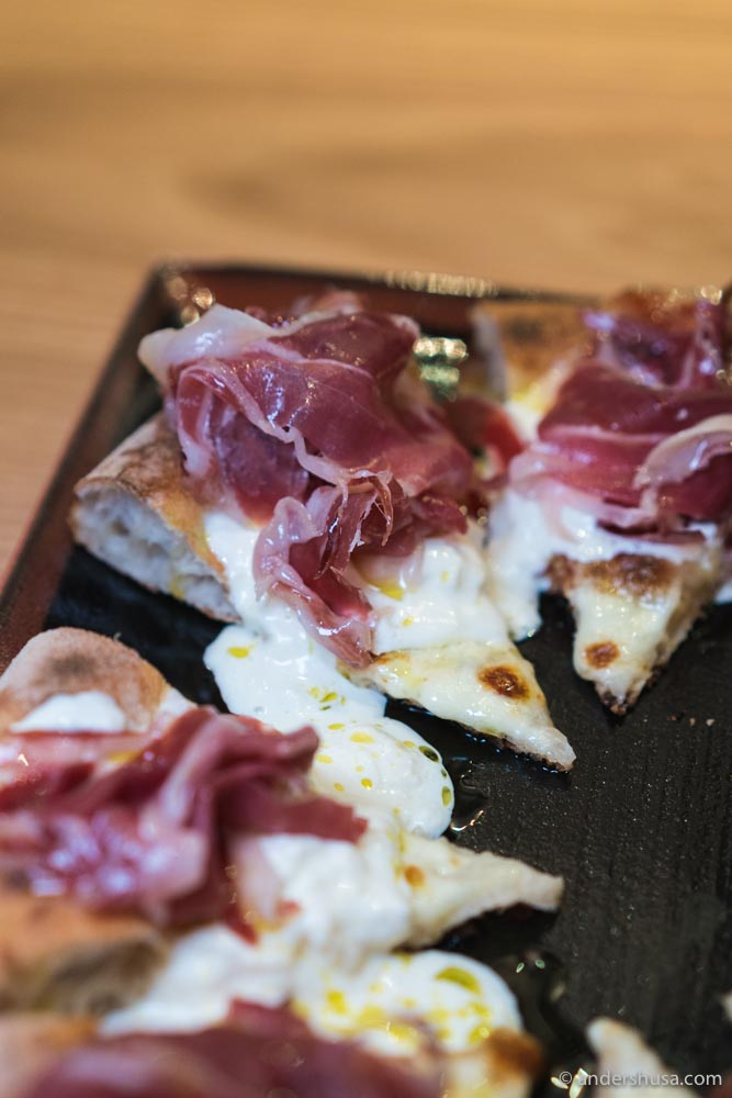Our favorite pizza at Vinoteket is topped with pata negra and burrata.