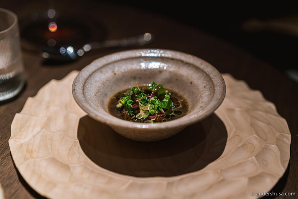 Lamb heart and saddle, kale, oxalis, and wood sorrel in a mushroom broth. On the side was a brioche glazed with lavender honey and lamb fat.