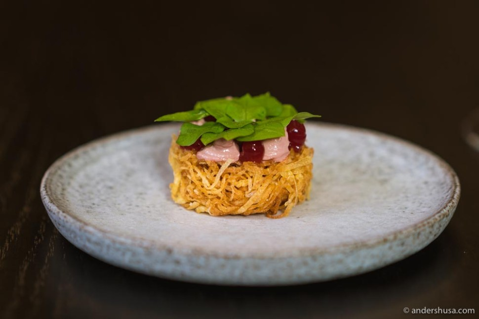 Potato nest filled with duck liver and lingonberry.