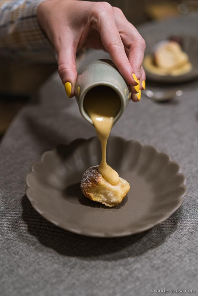 Buchteln (sweet brioche rolls) with vanilla sauce.