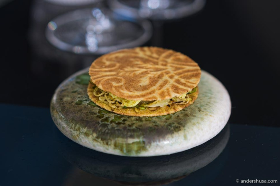 """""""Gode råd"""" (good advice) cookies with Limfjord oyster and grilled cabbage."""