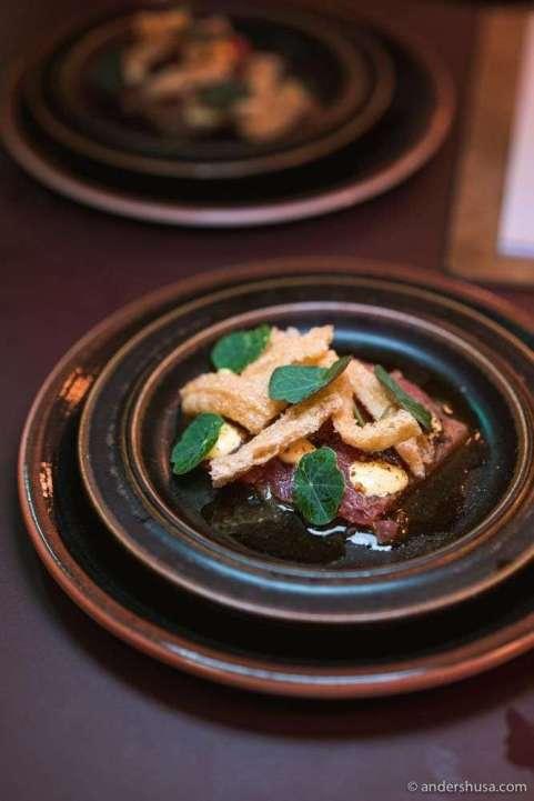 Tuna tiradito with aji amarillo, garlic, and truffle emulsion.