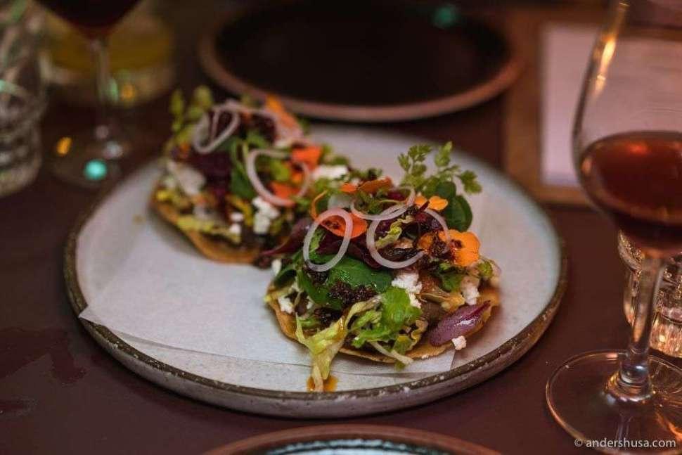 Tostada de frijoles – black beans, gem salad, salsa roja, queso, and herbs.