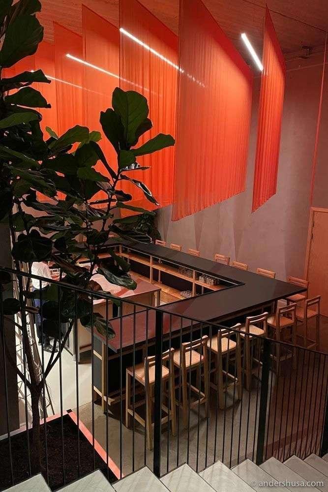 The U-shaped ramen bar downstairs at kōnā.